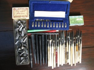 Collection of vintage ink pens and nibs