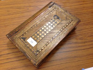 Decorative inlaid straw-work box. 19th Century possibly made by 19th Century French Napoleonic Prisoner of War. Book shaped with drawers and mirror. Sold for £310.