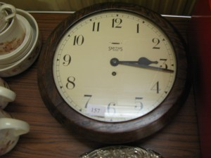 Lot 157 - Wall clock with wooden surround. Sold for £60.