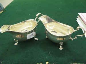 Lot 308 - Two Harrods silver plated sauce boats - Sold for £120