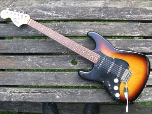 Strat electric guitar Squier by Fender Affinity Series 20th Anniversary edition LEFT HANDED. Made in China. Recently restrung with Roto Pinks super light. In good order bar the rust on the screws and the odd scratch and dint.