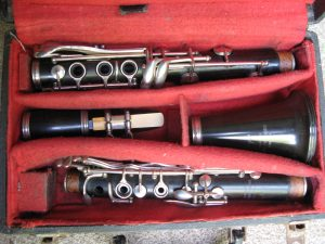 """Clarinet – Boosey and Hawkes """"77"""" London. Made of probably Rosewood with a resin bell. In good order with reed, ligature and case. No cap."""