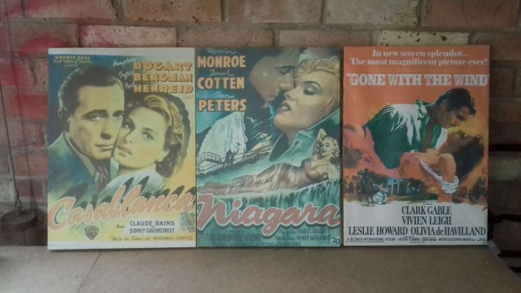 Reproduction posters of Casablanca, Niagara and Gone with the Wind