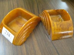 Lot 238 - A pair of Bakelite sponge holders - Sold for £35