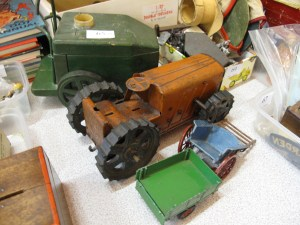 Lot 65 - Triang tractor, carts and another - Sold for £35