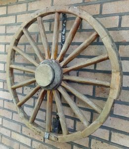 Decorative and well-aged Cart Wheel. Complete with metal bracket for fixing to wall. 82 Cm Diameter (approx.)