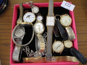Lot 122 - Box of watches - Sold for £28