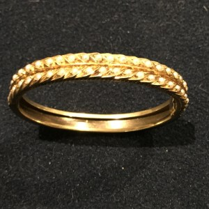 Gold and seeded pearl bangle. Estimate £200-£300
