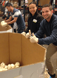 Cory, Nhung, and Andrew Sorting Through Onions