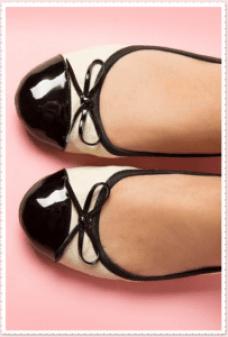 Cream and black ballerina shoes