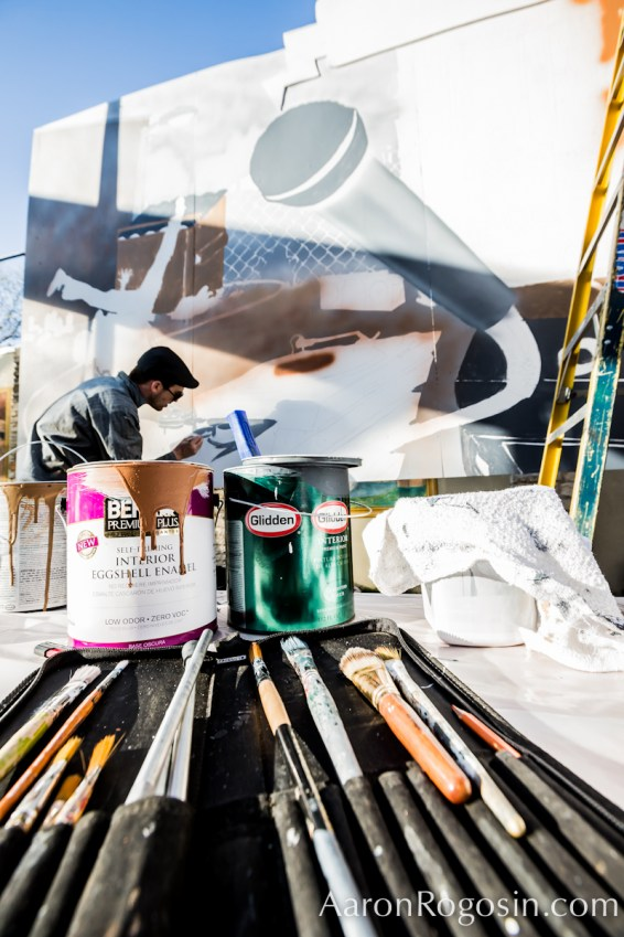 cans of paint in the fore ground - bold mural