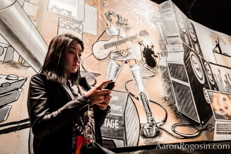 woman on cell phone by mural