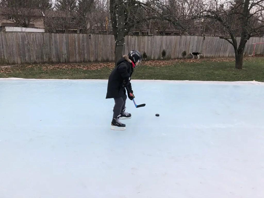 playing backyard ice hockey