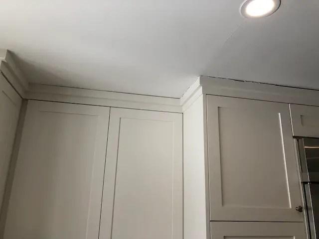 how to caulk kitchen cabinets