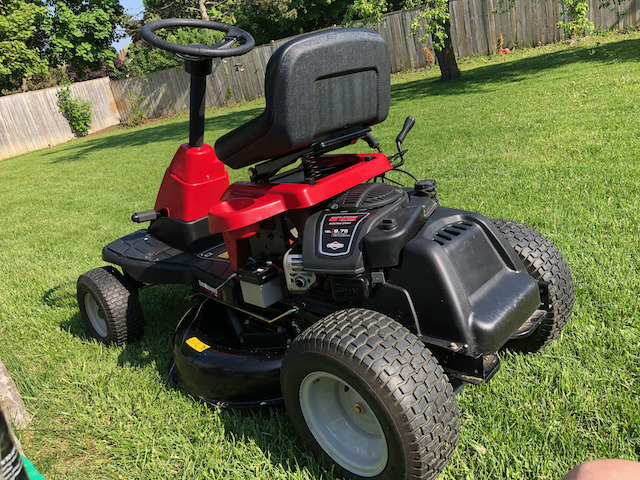 Yardworks riding lawnmower for cutting a residential backyard