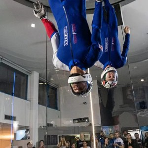 indoor skydiving athletes flying in the wind tunnel