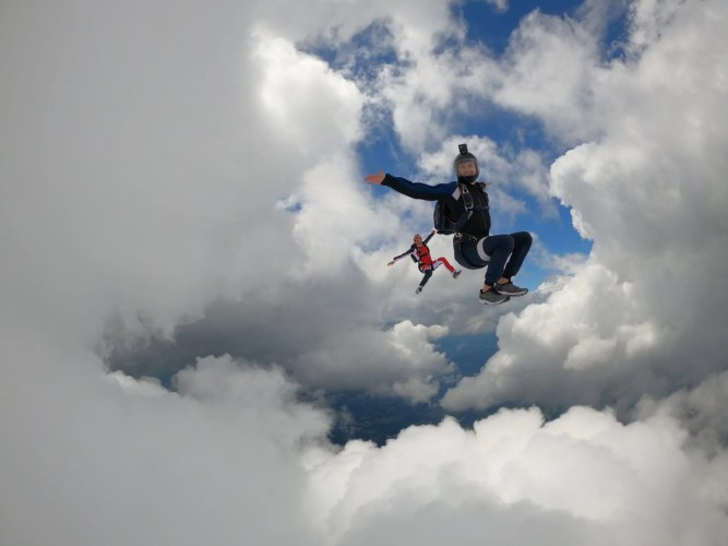free flying jump with 2 friends in the middle of clouds in Brazil