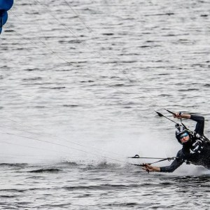 skydiving swoop over the water during competition