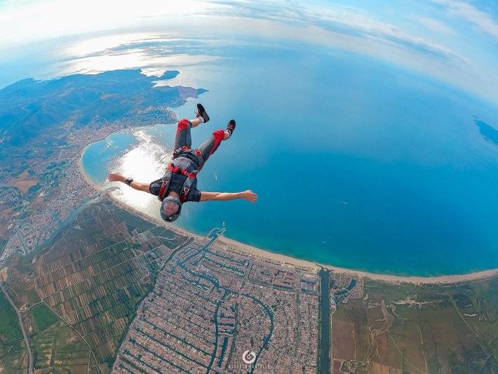 This photo illustrate how fun a 2 way skydiving jump can be. Mauro Jasmin smile while in free fall at skydive Empuriabrava is priceless.