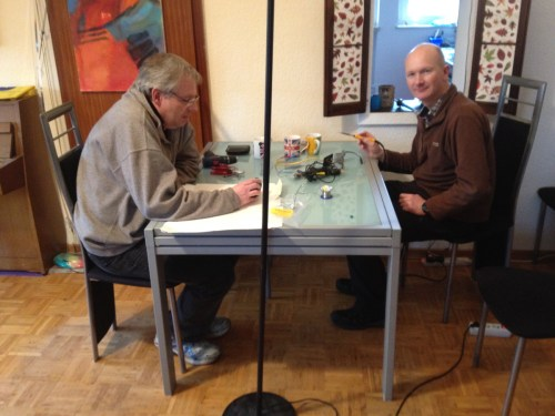 Two engineers soldering