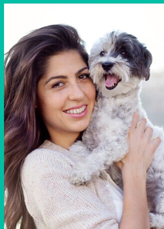 Smiling-women-holding-dog