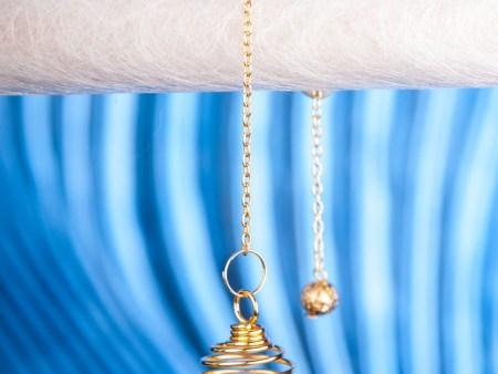 Spiralpendel mit  Bergkristall, vergoldet
