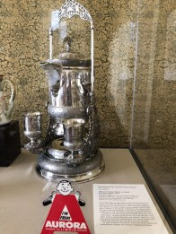"The tilting pitcher on display in Springfield with Aurora Historical Society character, ""Andy Aurora"""