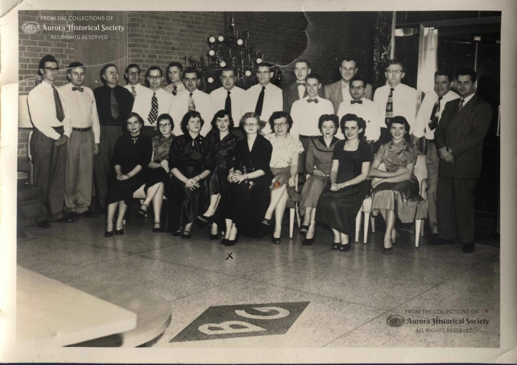 Barber Greene employees in lobby December 1955. In center front is Jackie Shanahan who was AHS Office Manager for 20 years until 2013. (Aurora Historical Society Photo)