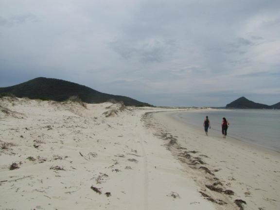 The girls walking along Jimmy's Beach towards the Yaccaba Headland