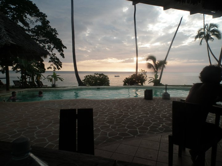 The sun sets over the pool at Mango Bay in Fiji