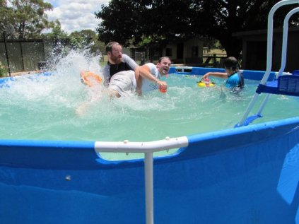 Two boys wrestling in a pool