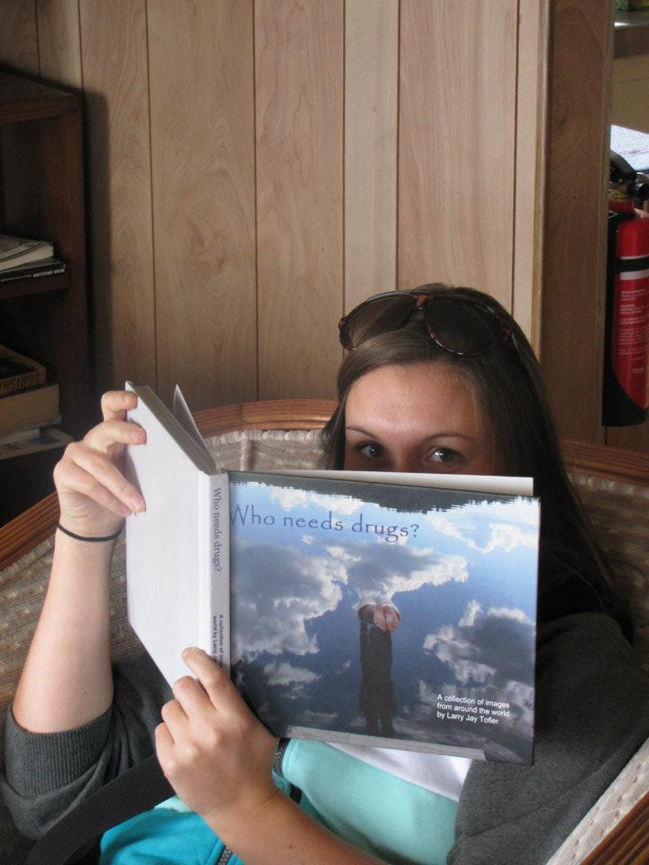 Annie reading Larry's photography book