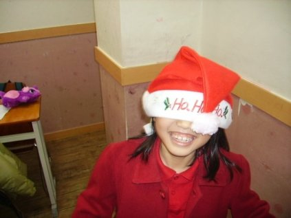 A Korean student wearing a Christmas hat