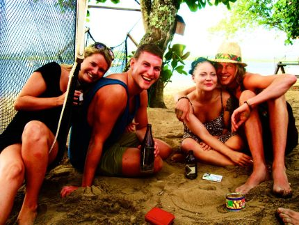 Backpackers partying on Robinson Crusoe Island, Fiji