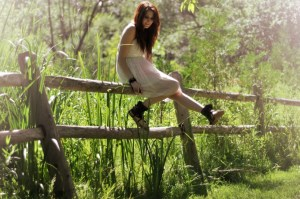 Beautiful redhead on a fence