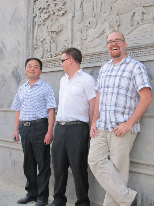 Two white guys and a Chinese guy
