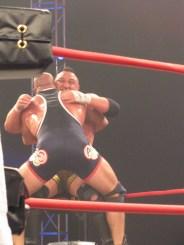 Kurt Angle suplexes Samoa Joe