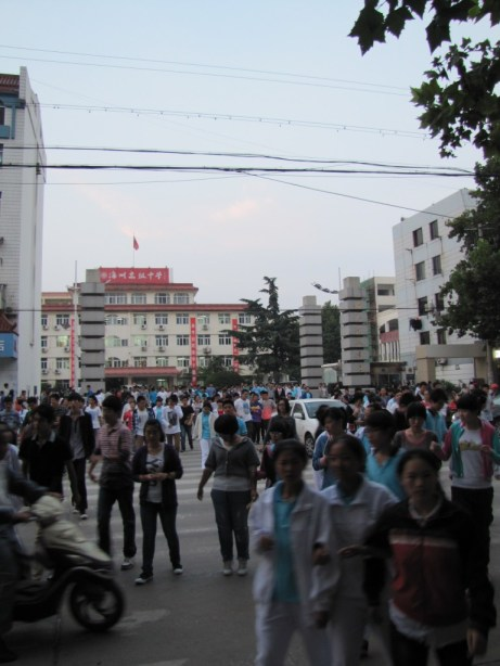 A crowd stops traffic
