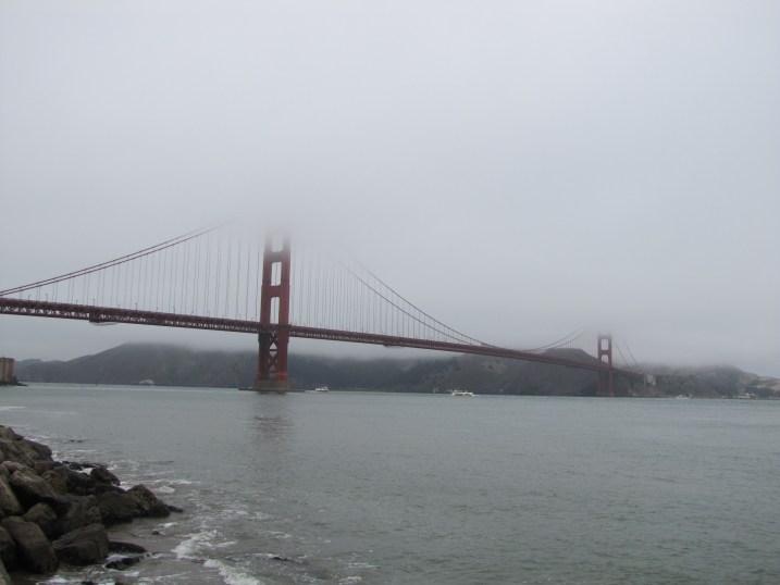 The Golden Gate Bridge dressed as she so often is: in fog