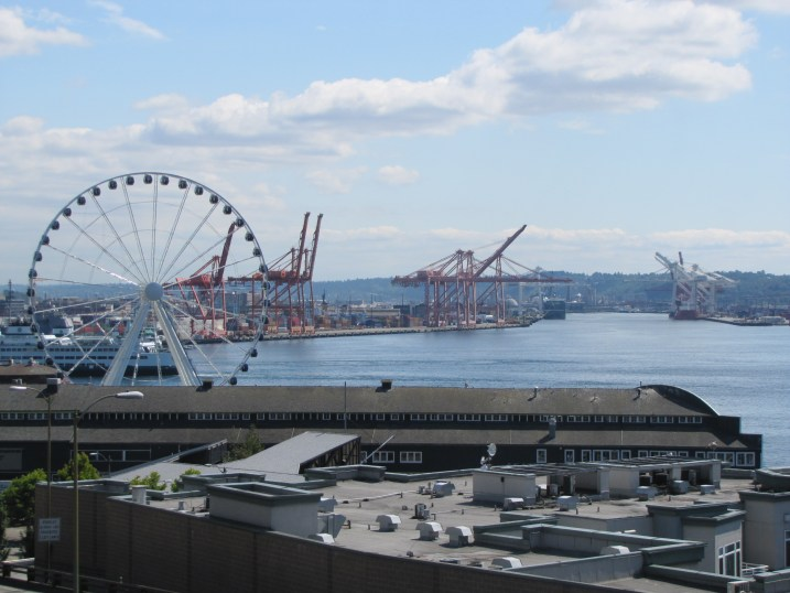 The ferris wheel and the (very industrial) skyline around Pike's Place Market.