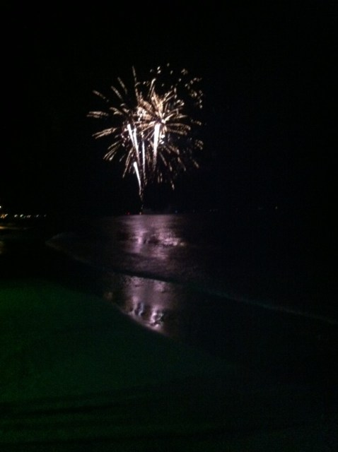 Fireworks explode over White Beach to ring in the Chinese New Year.