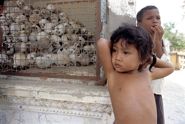 A child at the Killing Fields Memorial outside of Phnom Penh. Photo by UN Photo.