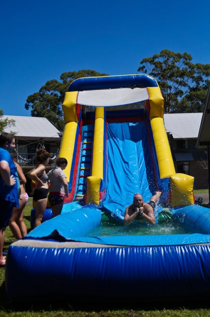 Riding the waterslide and doing some deep thinking at the O-Week Coastal Carnival