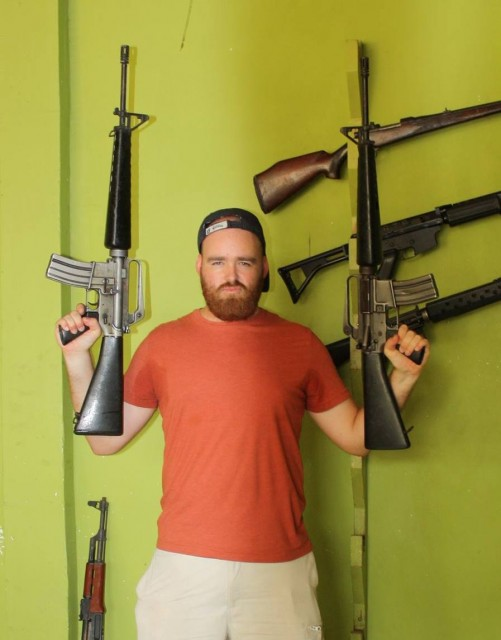 Posing with a pair of M16s in Cambodia in 2013.