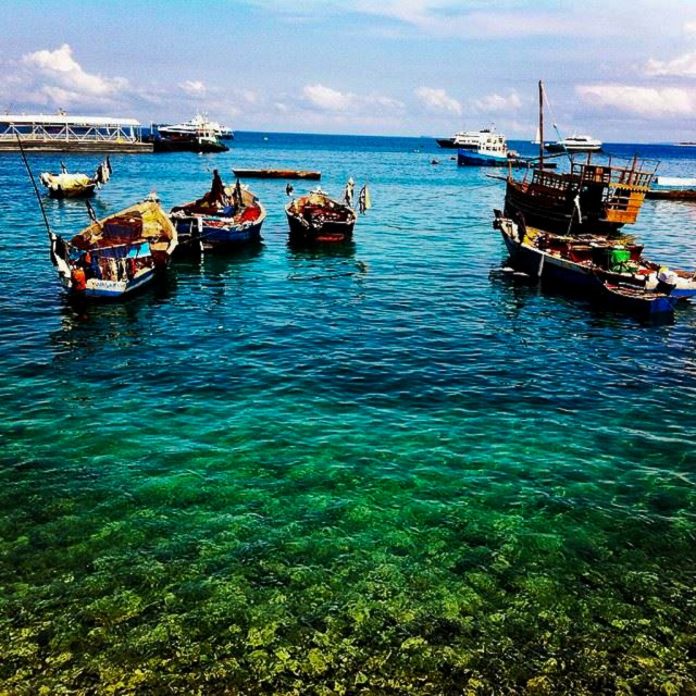 Fishing boats in the crystal clear waters of Zanzibar's Stone Town.
