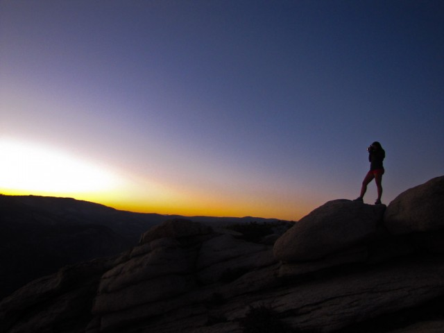 Nomadic American perches on a rock to capture the sunset from Sentinel Dome.