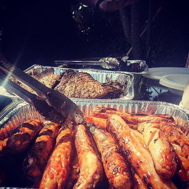Australian BBQ of sausages, chicken, and steak.