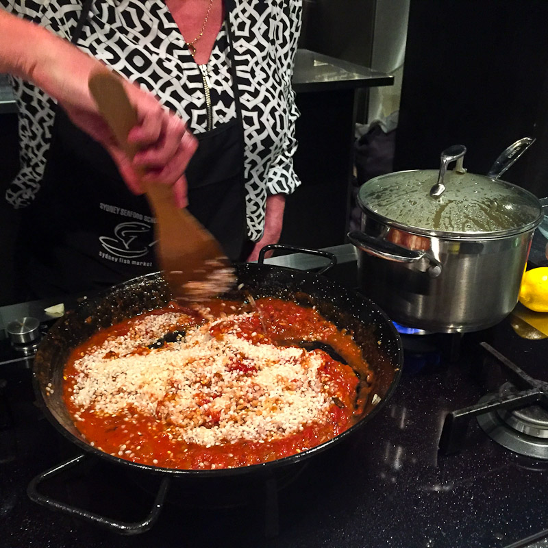 Stirring seafood paella
