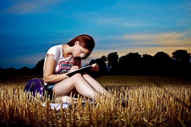 the harvest writer girl writing in journal