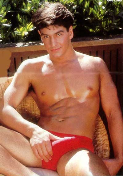 Cute guy wearing red speedos.